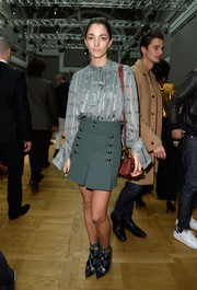 Sofia Sanchez Barrenechea kept it classic in a gray silk tie-neck blouse by Chloe during the label's fashion show.