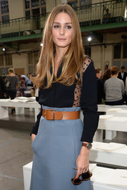 Olivia Palermo donned a subtly sexy midnight-blue button-down with see-through side panels for the Chloe fashion show.