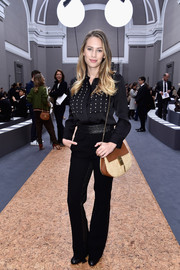 Dylan Penn was androgynous-chic in a pearl-embellished black button-down during the Chloe fashion show.