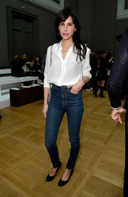 Caroline Sieber chose a pair of high-waisted blue jeans to team with her blouse.