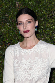 Jessica Pare added a shock of color to her look with dark berry lipstick.