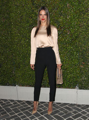 Alessandra Ambrosio played with proportions, pairing cigarette pants with her loose blouse.