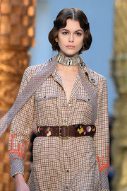 Kaia Gerber accessorized with an embellished brown leather belt at the Chloe Fall 2020 show.