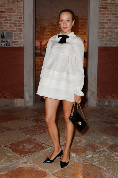 Chloe Sevigny Kitten Heels [miu miu womens tales dinner,clothing,white,fashion model,fashion,shoulder,leg,beauty,street fashion,snapshot,dress,chloe sevigny,venice,italy,venice film festival]