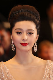 Fan Bingbing pulled her hair back in a smooth bun while hitting the Cannes Film Festival. Her braided bun was the perfect look for the coveted occasion.