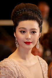 Fan rarely goes without red lipstick. The Chinese actress gave her look a boost with matte red lips.
