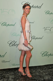 Nicky Hilton paired her silver strappy heels with a sparkling box clutch.