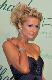 Paris Hilton loves her diamonds. Here she showed off a pair of dazzling diamond earrings.