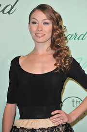 Eleonora showed off her long side swept curls while attending the Chopard after party.