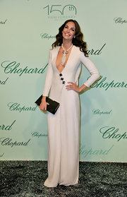 Eugenia Silva took the plunge in her white floor length gown. She paired her sultry ensemble with a black buckle clutch.