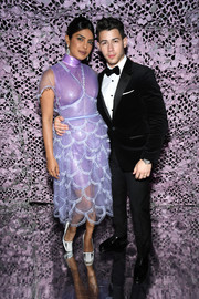 Priyanka Chopra attended the Chopard Love Night dinner wearing a lavender cocktail dress with a scalloped skirt.