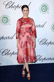 Livia Firth looked elegant and sophisticated in a red and pink pleated dress with fun abstracts prints.