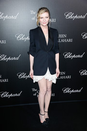 Kirsten Dunst paired a black blazer with a lacy LWD for the 'Garden of Kalahari' movie presentation.