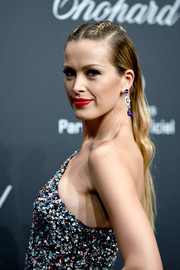 Petra Nemcova kept it fun with this loose hairstyle with a double-braided top at the Chopard Space Party.
