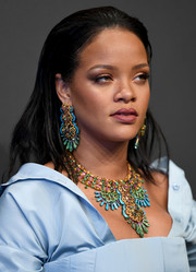 Rihanna went extra bold with her accessories, wearing a pair of huge, multicolored chandelier earrings by Chopard.