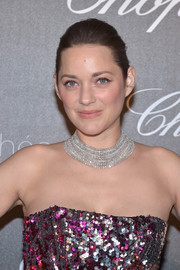 Marion Cotillard opted for a simple bun when she attended the Chopard Trophy photocall.