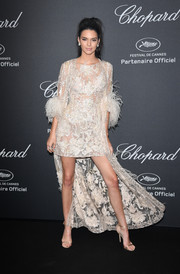 Kendall Jenner complemented her dress with gold satin ankle-strap sandals by Jimmy Choo.