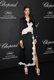 Adriana Lima looked subtly sexy in this black-and-white lace-trimmed dress by Alessandra Rich at the Chopard Wild Party.