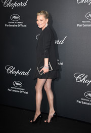 Kate Moss paired a pearl-adorned clutch with a black skirt suit for her Chopard Wild Party look.