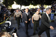 Chris Brown wore a somber grey tie when arriving at his arraignment in Los Angeles.