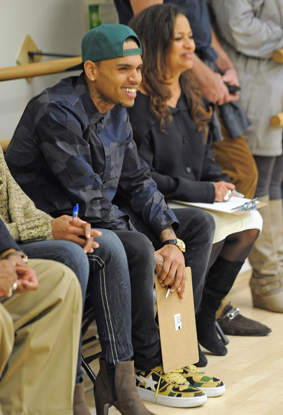 Chris Brown looked amused as he paid a visit to the Debbie Allen Dance Academy while wearing his trademark baseball cap.