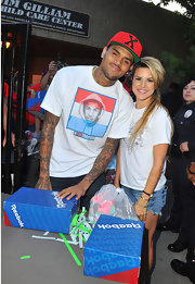 Chris Brown wore a statement T-shirt while distributing shoes at the Walk in Unity event in LA.