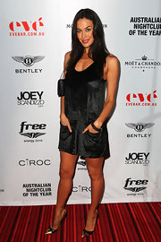Megan Gale added some shimmer to her dark outfit with a pair of gold and black cap-toe pumps when she attended the Chris Judd launch party.