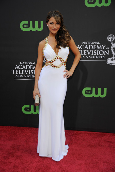 Chrishell Stause Tube Clutch [dress,red carpet,clothing,shoulder,carpet,gown,flooring,fashion,premiere,neck,arrivals,chrishell stause,california,los angeles,the orpheum theatre,daytime entertainment emmy awards,daytime emmy awards]