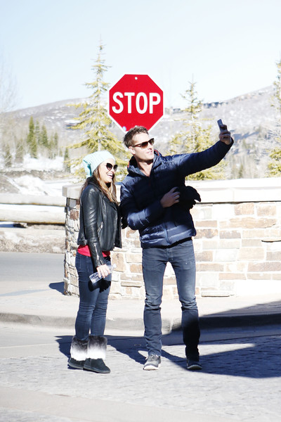 Chrishell Stause Leather Jacket [photograph,red,snapshot,standing,photography,fun,jacket,gesture,winter,outerwear,justin hartley,the rodosky family,chrishell stause,utah,park city,operation smile,celebrity ski smile challenge]