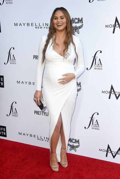 Chrissy Teigen Maternity Dress [white,fashion model,flooring,shoulder,joint,leg,carpet,cocktail dress,fashion,catwalk,arrivals,shoe,chrissy teigen,fashion model,flooring,fashion,beverly hills hotel,daily front row,the daily front row,4th annual fashion los angeles awards,kylie jenner,fashion,clothing,dress,beverly hills,celebrity,daily front row,skirt,shoe]