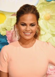 Chrissy Teigen styled her locks into a gorgeous teased pony for the Glass-Slipper-Ready pedicure event.