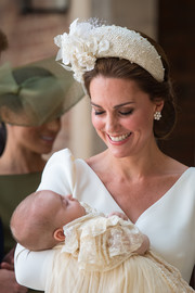 Kate Middleton accessorized with an oversized white headband by Jane Taylor for Prince Louis' christening.