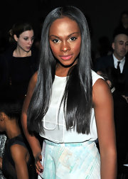 Tika Sumpter attended the Christian Cota fashion show with straight center part locks.
