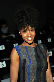 Yaya rocked her natural curls that were pinned up in a high coif at the Christian Cota fashion show.