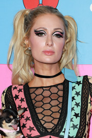 Paris Hilton kept it cute and youthful with these pigtails at the Christian Cowan x The Powerpuff Girls event.