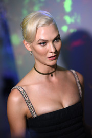 Karlie Kloss brought some Old Hollywood glamour to the Christian Dior '70 Years of Creation' exhibition with this elegant platinum-blonde updo.