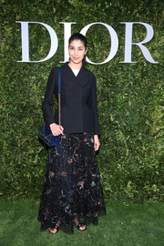 Caroline Issa softened her mannish top with an embroidered maxi skirt, also by Dior.