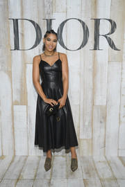 Alexandra Shipp was equal parts edgy and sweet in a black fit-and-flare leather dress by Dior during the label's Cruise 2019 show.