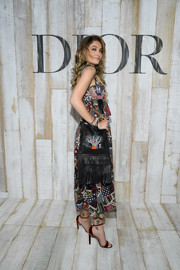 Paris Jackson paired a fringed shoulder bag with a patchwork dress, both by Dior, for the label's Cruise 2019 show.