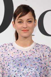 Marion Cotillard slicked her hair back into a neat ponytail for the Christian Dior Cruise 2015 show.