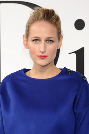 Leelee Sobieski's pink lipstick provided a lovely contrast to her blue dress at the Dior Cruise show.
