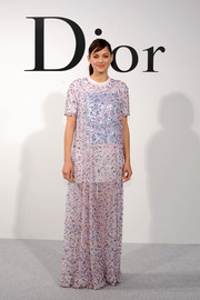 Marion Cotillard covered up in a Dior beaded maxi dress worn with a T-shirt underneath for the Christian Dior Cruise 2015 show.