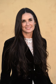 Demi Moore attended the Christian Dior Cruise 2018 show wearing her signature waist-length waves.
