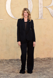 Laura Dern sported a black Dior pantsuit during the label's Cruise 2018 show.