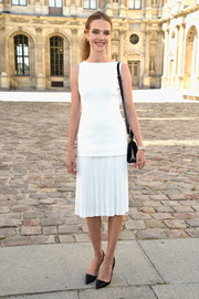 Natalia Vodianova was all about simple elegance at the Dior show in a little white dress with a pleated skirt.