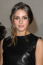 After defining her eyes with dark brown liner, Olivia Palermo added a wash of shimmering gold shadow for warmth and sparkle.