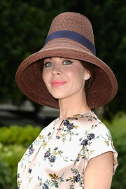 Ulyana Sergeenko was a breath of summer air in her banded straw hat and floral outfit during the Dior Couture fashion show.