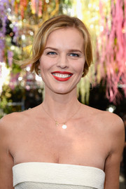 Eva Herzigova wore a soft, loose ponytail when she attended the Christian Dior fashion show.