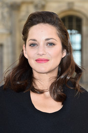 Marion Cotillard wore her hair slicked back at the top and wavy down the ends during the Dior fashion show.