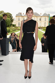 Marion Cotillard went for modern elegance in an asymmetrical black Dior top, featuring fold-over detailing and a printed panel, during the label's fashion show.